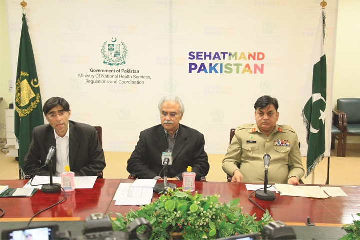 ISLAMABAD: Special Assistant to the PM on Health Dr Zafar Mirza, SAPM on National Security Division Dr Moeed Yusuf and National Disaster Management Authority chairman Lt Gen Mohammad Afzal addressing a press conference on Saturday.—White Star