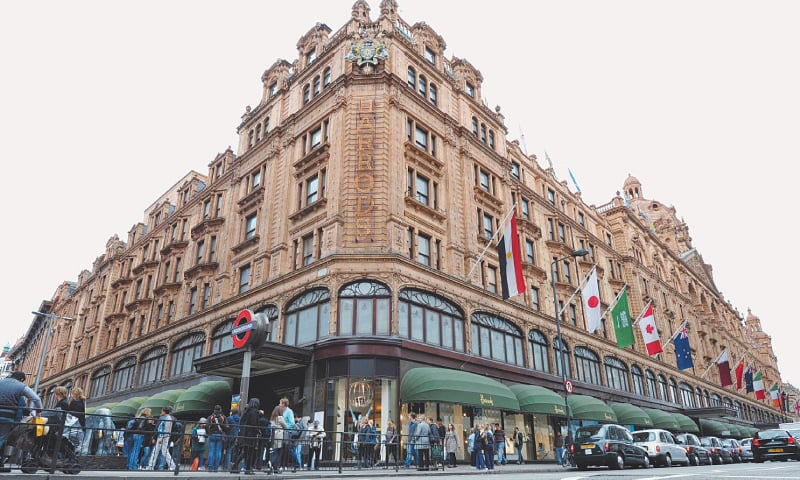 In this file photo taken on May 08, 2010 People walk in front of the Harrods department store in London. Where the Blitz failed, coronavirus has succeeded. The luxury London store Harrods, which stayed open throughout the bombing of the capital during World War II, announced last week it was closing its doors.—AFP