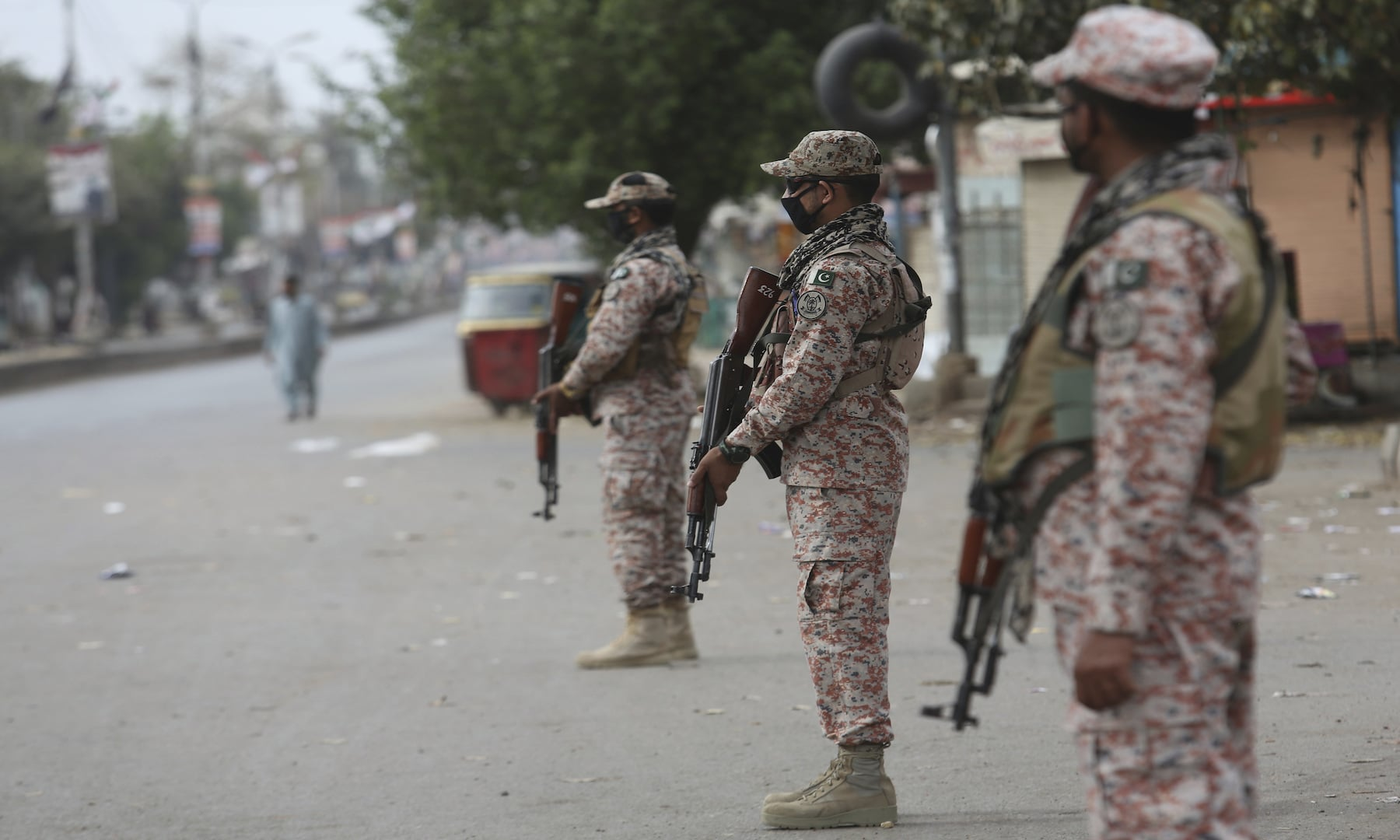 Security personnel stand guard after the government announced a lockdown in Karachi. — AP