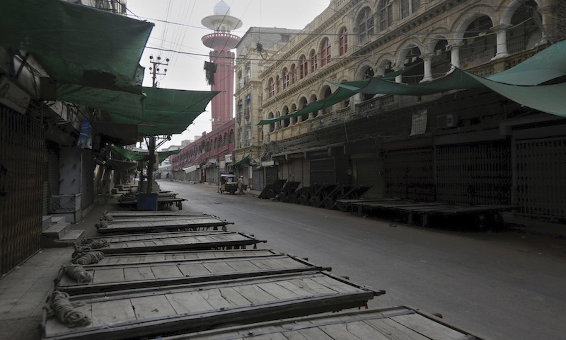 A view of a downtown market seen empty during restrictions in Karachi. — AP