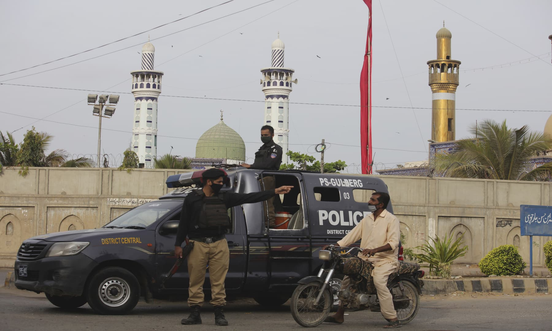 A police officer stops a motorcyclist amid a lockdown in Karachi on Monday. — AP