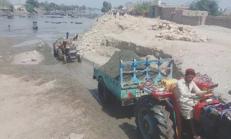 SAND collected from Rice Canal bed being transported in a tractor-driven trolley.—PPI
