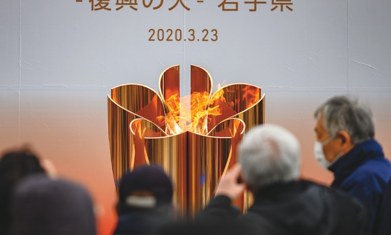 THE Tokyo 2020 Olympic flame is displayed at Ofunato, Iwate prefecture, on Monday.—AFP