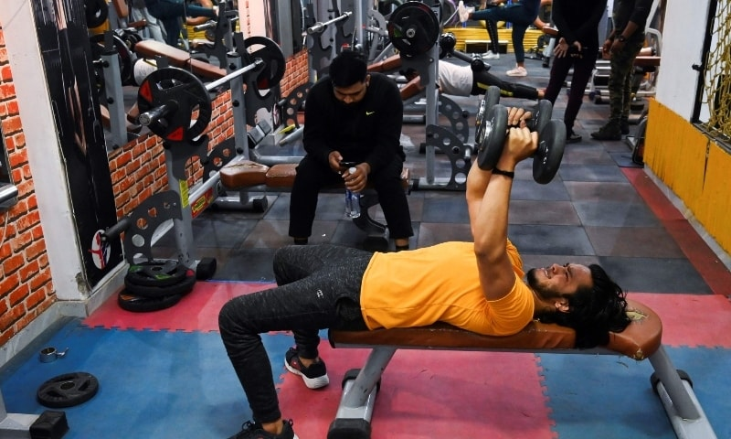In this picture taken on March 19, a patron exercises in a gym in New Delhi. — AFP