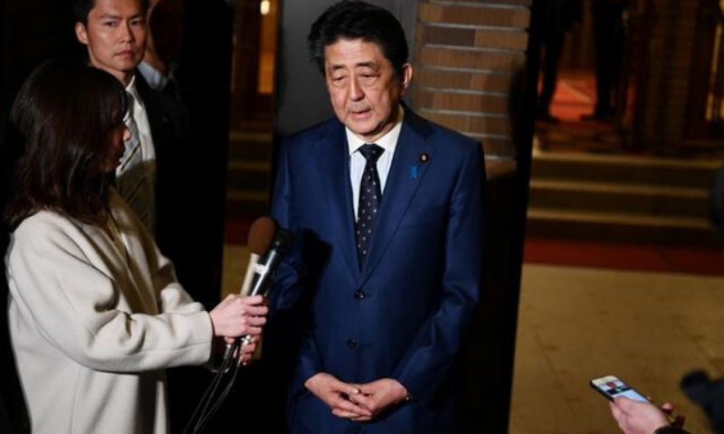 Japan's prime minister Shinzo Abe talks to journalists after a phone call with IOC president Thomas Bach on postponing the Olympic Games. —Reuters