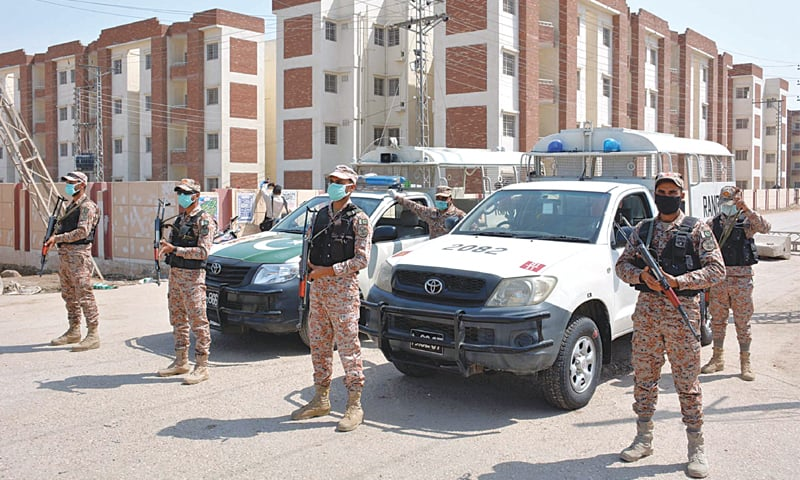RANGERS personnel guard the Sukkur quarantine centre where the pilgrims were discharged on Tuesday.—PPI