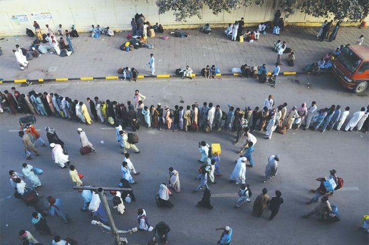 A serpentine line forms outside Cantt Station on Tuesday as people rushed to grab a spot on trains before the railways' shutdown took effect.—Shakil Adil/White Star