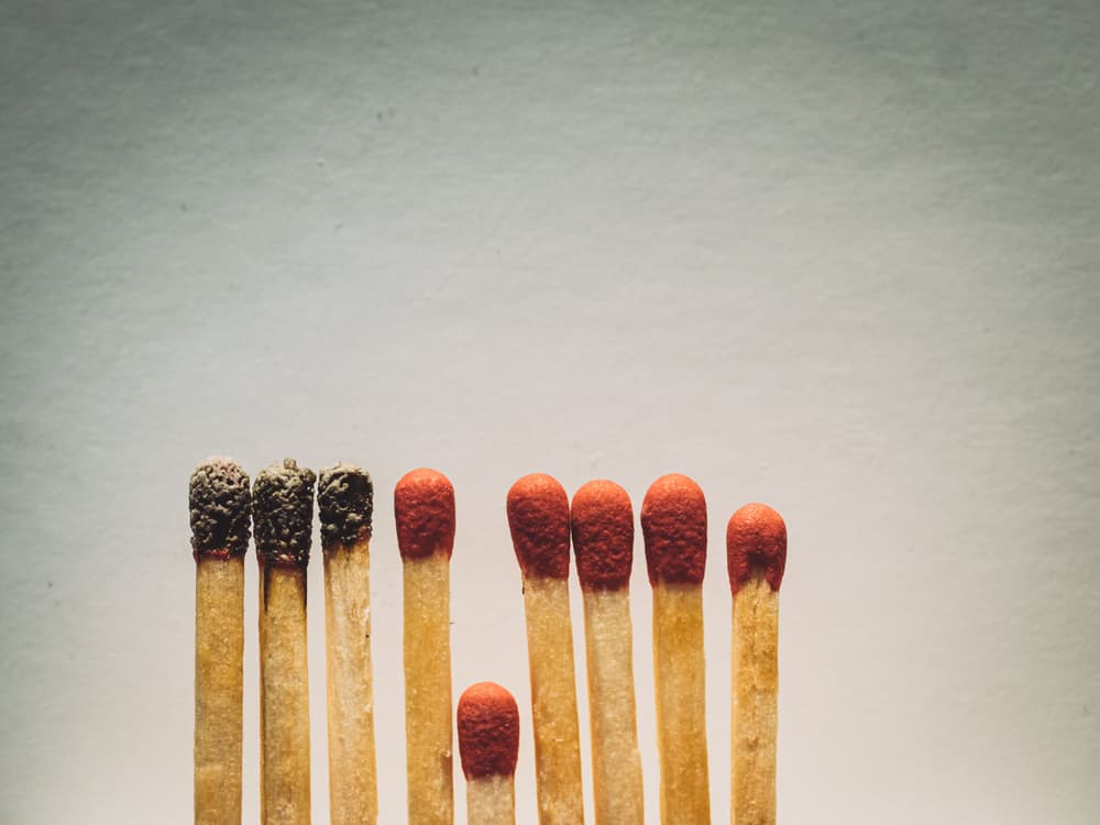 Matchsticks burn, one stick prevents the fire from spreading —the concept of how to stop the coronavirus from spreading: isolation, stay at home and social distance.