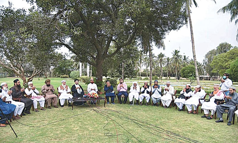 THE group of religious scholars who met the Sindh governor offer dua after speaking to the media on Wednesday.—APP