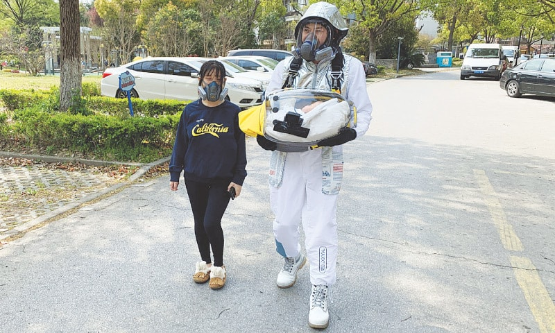 Shanghai: Cao Junjie walks around a residential compound to demonstrate for the camera a safety pod he created to protect his two-month old baby from coronavirus.—Reuters