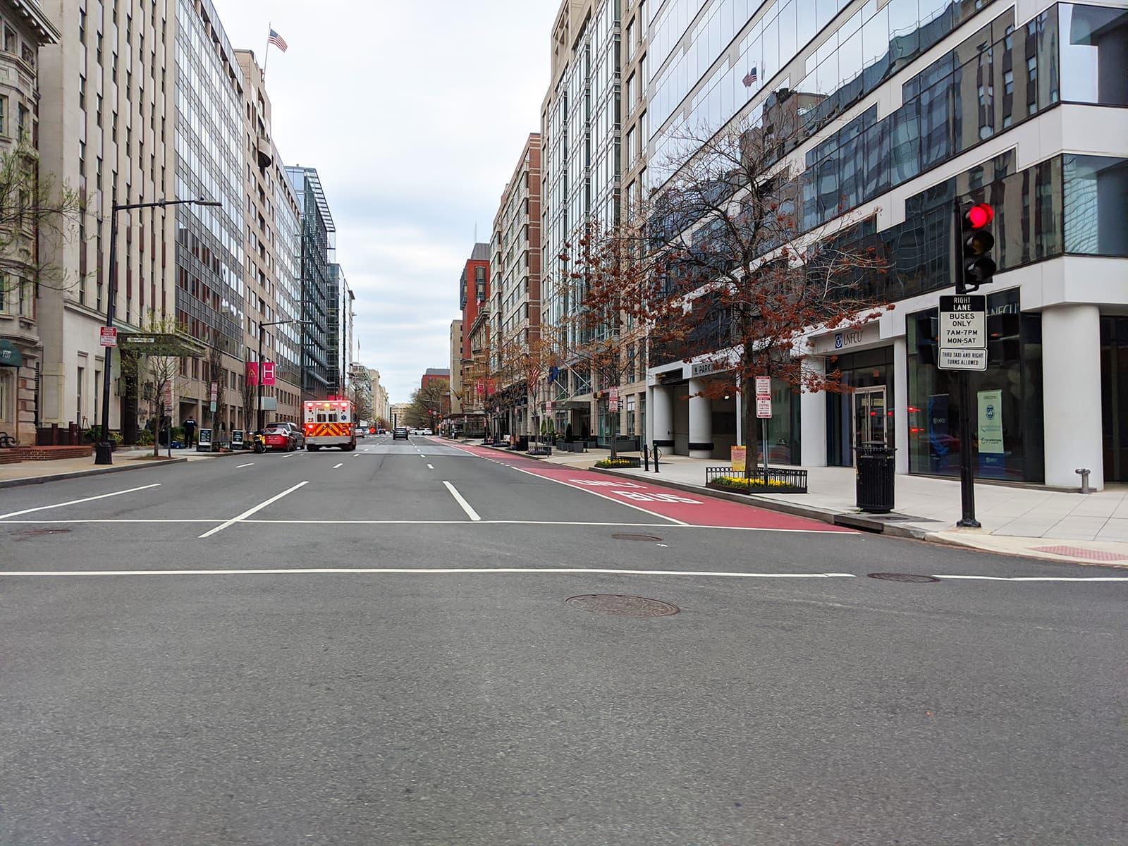 An ambulance occupies a barren street in downtown DC. - Picture by Author
