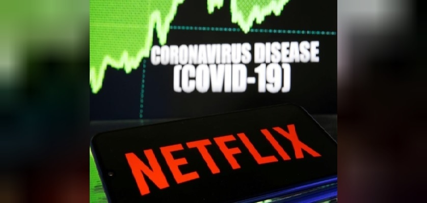 Netflix logo is seen in front of diplayed coronavirus disease Covid-19 in this illustration taken March 19. — Reuters