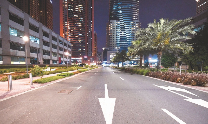DUBAI: An empty street before curfew on Thursday.—AFP