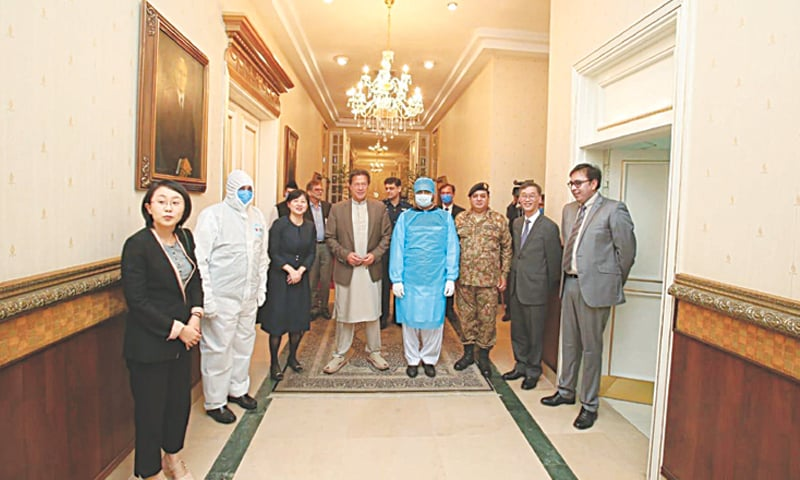 ISLAMABAD: Prime Minister Imran Khan pictured with Chinese Ambassador to Pakistan Yao Jing and members of his delegation at PM Office on Thursday. The ambassador said assisting Pakistan in its fight against Covid-19 is one of Beijing's priorities. China's assistance includes 12,000 testing kits, 300,000 masks, 10,000 protective suits and $4m for building a hospital. The Xinjiang government has, meanwhile, provided 50,000 masks each to Islamabad Capital Territory as well as the Sindh government.