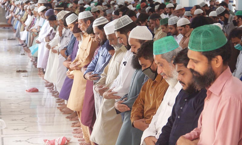 Worshippers offer congregational Friday prayers in parts of Karachi despite ban