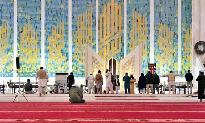 A few people seen at Faisal Mosque in Islamabad for Friday prayers. — Photo by Tanveer Shahzad