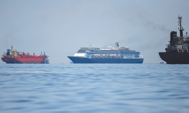 PANAMA CITY: A cruise ship enters the Panama City bay on Friday after the Panamanian government allowed it to do so as a large number of passengers showed flu symptoms.—AFP