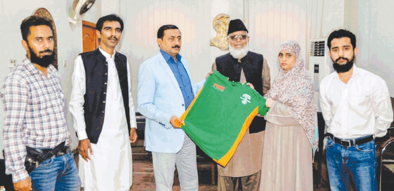 KARACHI:Additional DC South Zulfiqar Khushk hands over the girls basketball kits to KBBA women's wing secretary Zaeema Khatoon as FHM's Imran Faisal, President KBBA Ghulam Mohammad, Tufail Pitafi and Engr Zainul Abideen look on.