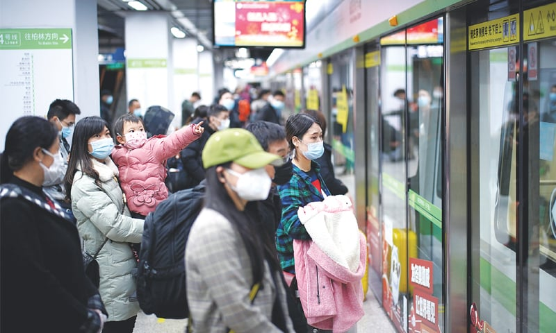 WUHAN (China): People wearing masks wait for a train on the first day of resumption of this city's public services on Saturday.—Reuters