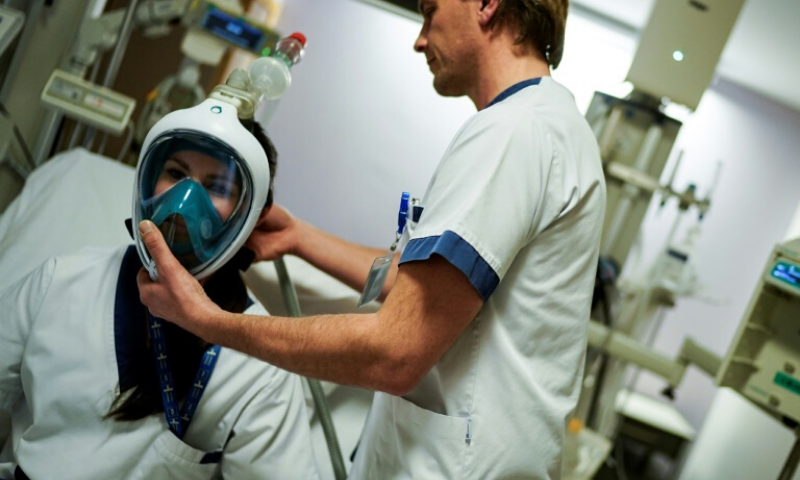 A custom-made valve fits to the top of full-face masks, where the snorkel is meant to go, allowing them to connect to standard BiPAP machines that feed pressurised air into masks. — AFP
