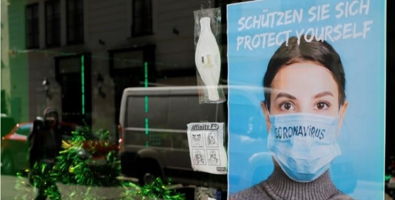 Face masks are on display in a closed shop during the spread of Covid-19 in Vienna, Austria on March 19. — Reuters
