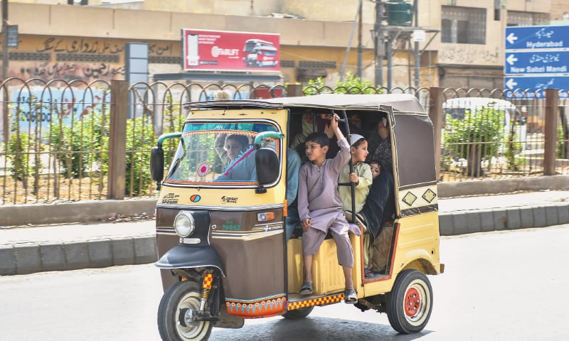 ALTHOUGH the Sindh chief minister has issued strict orders against travel of more than one passenger in a rickshaw, overloaded tri-wheelers and pickups are a common sight in the city.—Fahim Siddiqi / White Star