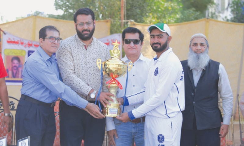 SHEIKH Talha receives man-of-the-final award from chief guest Mazhar Awan.