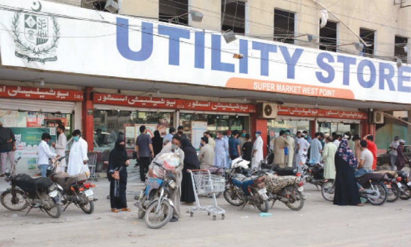 KARACHI: People wait for their turn to buy grocery items on subsidied prices at a utility store on Monday. The rush on the government stores is rising as retailers are charging higher prices cashing in on the Covid-19 lockdown.—PPI