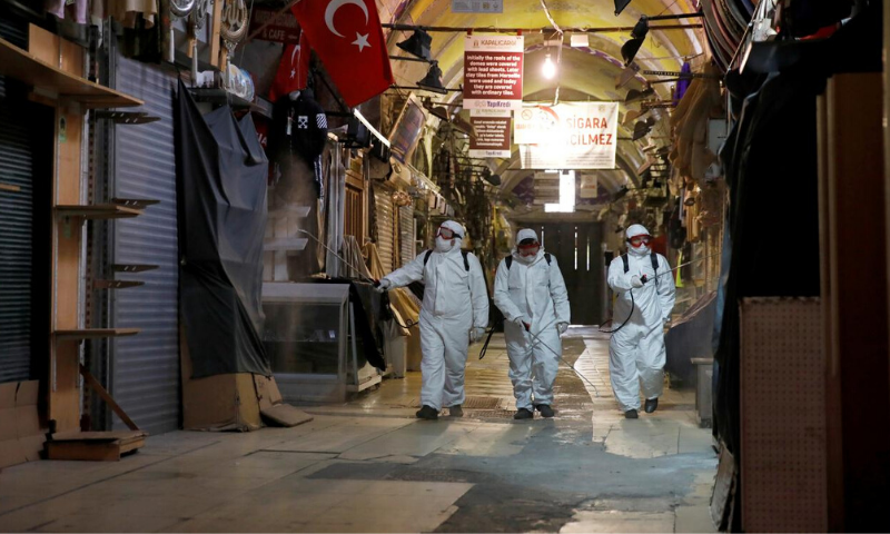In this February 2020 file photo, workers in protective suits spray disinfectant at Grand Bazaar, known as the Covered Bazaar, to prevent the spread of coronavirus disease in Istanbul, Turkey. —Reuters/File