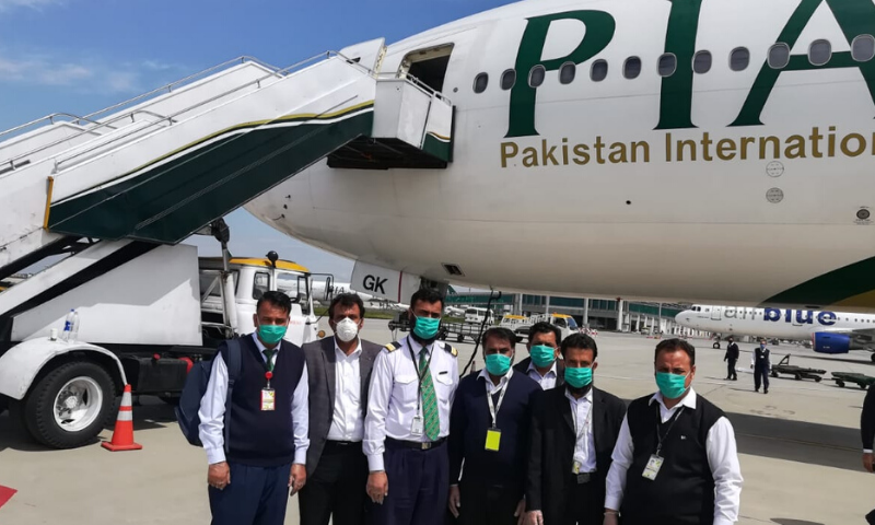 Seven members of the flight crew on the special PIA flight to Beijing.