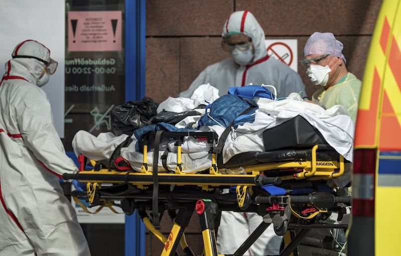 In this March 25, 2020, file photo, a patient with Covid-19, flown in an Italian Air Force plane from Italy is admitted to the Helios Klinikum in Leipzig, Germany. In the rare position of having beds to spare, German hospitals have taken in dozens of patients from Italy and France. — AP