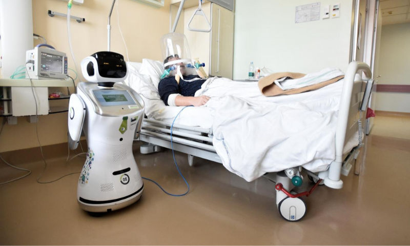 A robot helping medical teams treat patients suffering from the coronavirus disease is pictured at a patient's room, in the Circolo hospital, in Varese, Italy. —Reuters