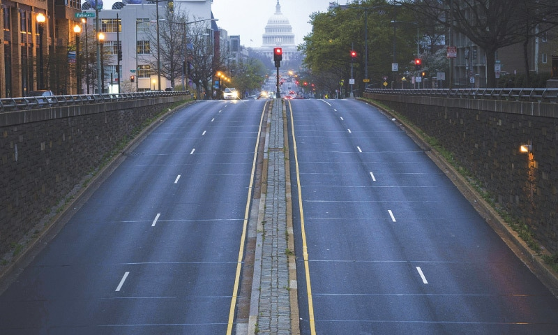 WASHINGTON: A mostly empty North Capitol Street is seen at dusk on Tuesday evening.—AFP