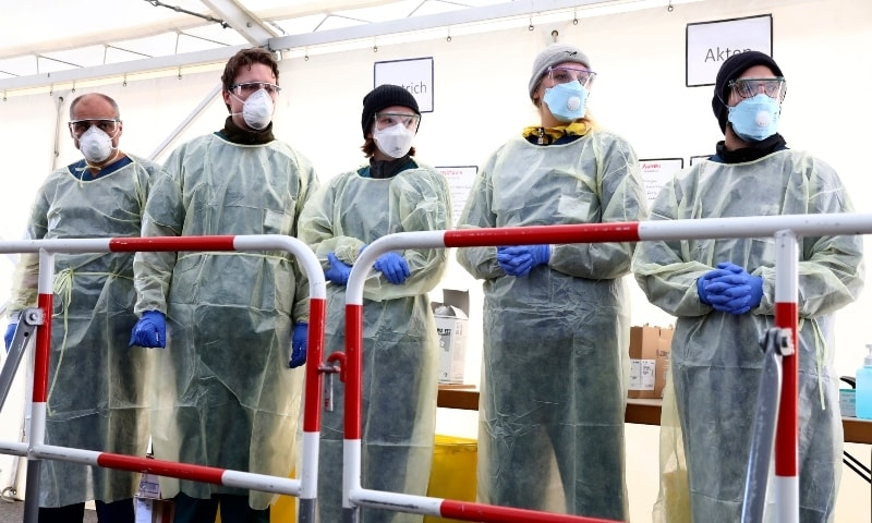 Medical employees wait to carry out tests at a coronavirus test center for public service employees, during a media presentation in Munich on March 23.