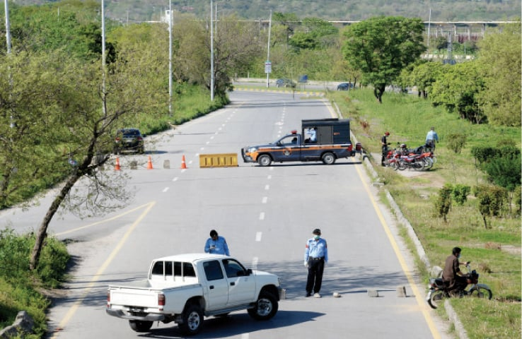Police have sealed a road at Faizabad to prevent people from entering Islamabad. — Photo by Mohammad Asim