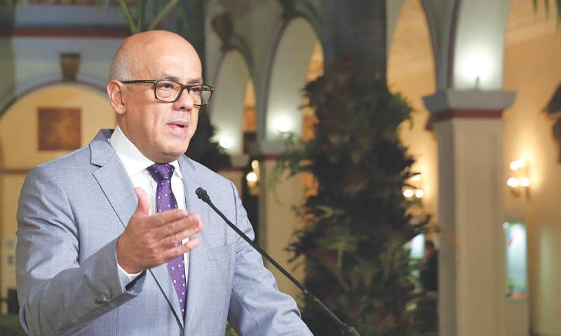 CARACAS: Venezuelan Minister of Communications Jorge Rodriguez delivering a speech repudiating US President Donald Trump's declarations.—AFP