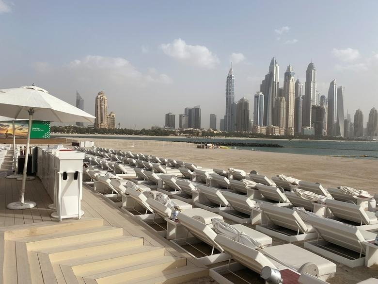 Empty sun-decks are seen at a beach, after a curfew was imposed in Dubai, United Arab Emirates, March 25, 2020. — Reuters