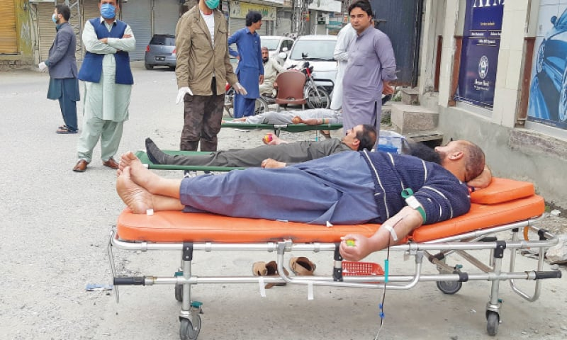 People donate blood in Mingora. — Dawn