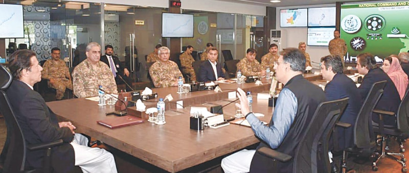 ISLAMABAD: Prime Minister Imran Khan attends a meeting during his visit to the newly-established National Command and Operation Centre for Covid-19 on Friday.—White Star