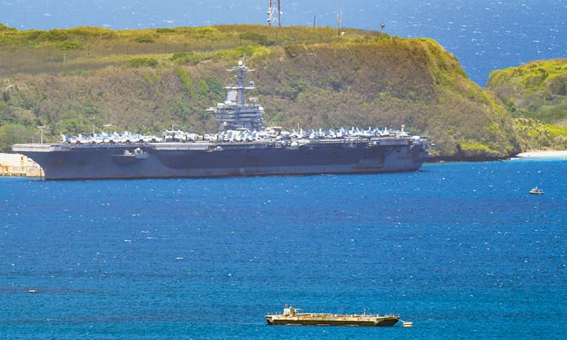 The US Theodore Roosevelt, a Nimitz-class nuclear powered aircraft carrier, is docked along Kilo Wharf of Naval Base Guam in Sumay, on Friday.—AP
