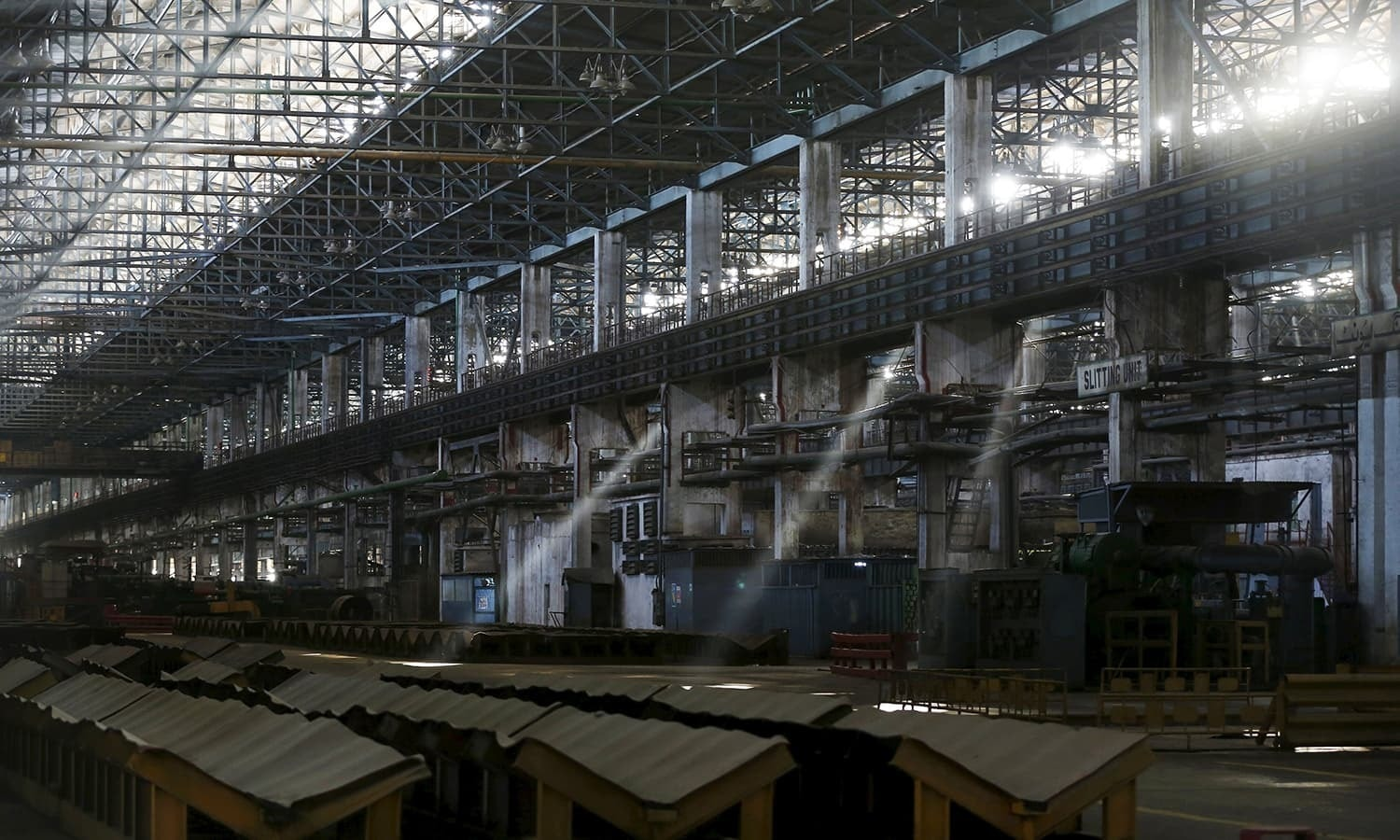 A general view of the deserted hot strip mill department of the Pakistan Steel Mills .— Reuters/File