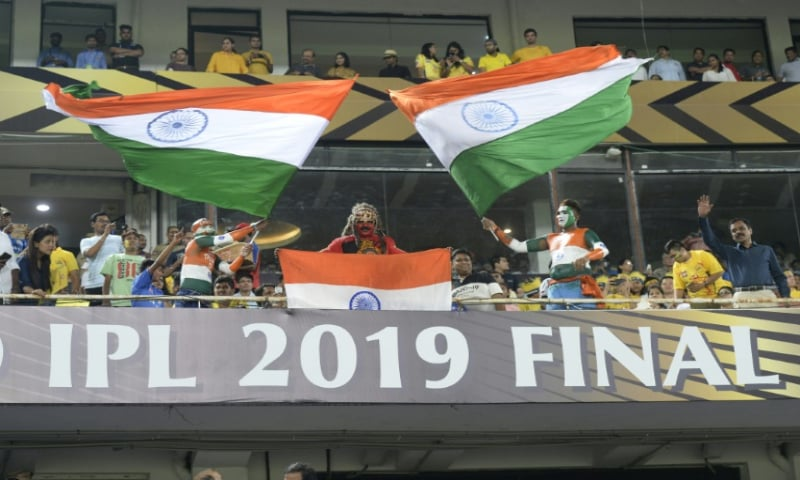 Fans wave national flags during last year's Indian Premier League final in Hyderabad. — AFP