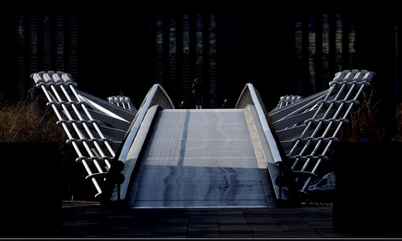 An empty view of the Millenium Bridge in London. — AP