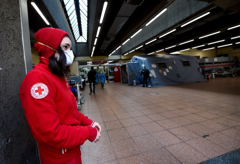 A member of the Red Cross wears a protective mask at the emergency unit of the Molinette Hospital on Palm Sunday, during the coronavirus disease outbreak in Turin, Italy, on April 5, 2020. — Reuters