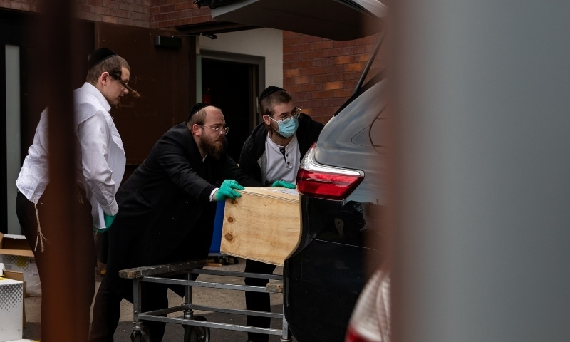 Men load a casket into a car outside a funeral home during the outbreak of the coronavirus disease (COVID-19) in the Brooklyn borough of New York City on April 5. — Reuters