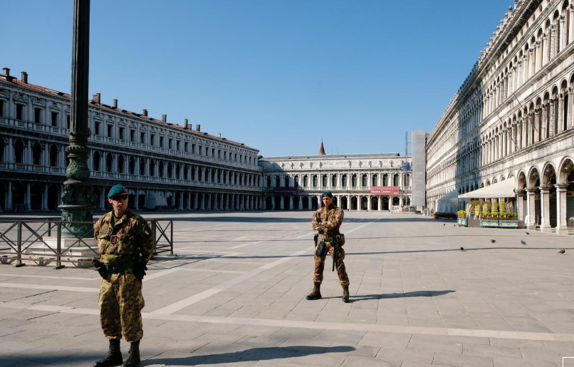 Soldiers patrol an empty Saint Mark's Square on Palm Sunday, following Covid-19 outbreak in Venice, Italy, April 5. — Reuters