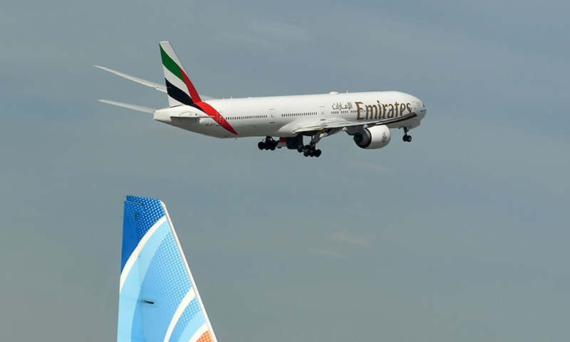 An Emirates aircraft takes off from Dubai International Airport on April 6. — AFP