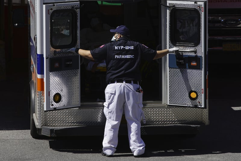 A paramedic closes the doors to an ambulance outside Elmhurst Hospital during the outbreak of the coronavirus disease in the Queens borough of New York City on April 6, 2020. — Reuters