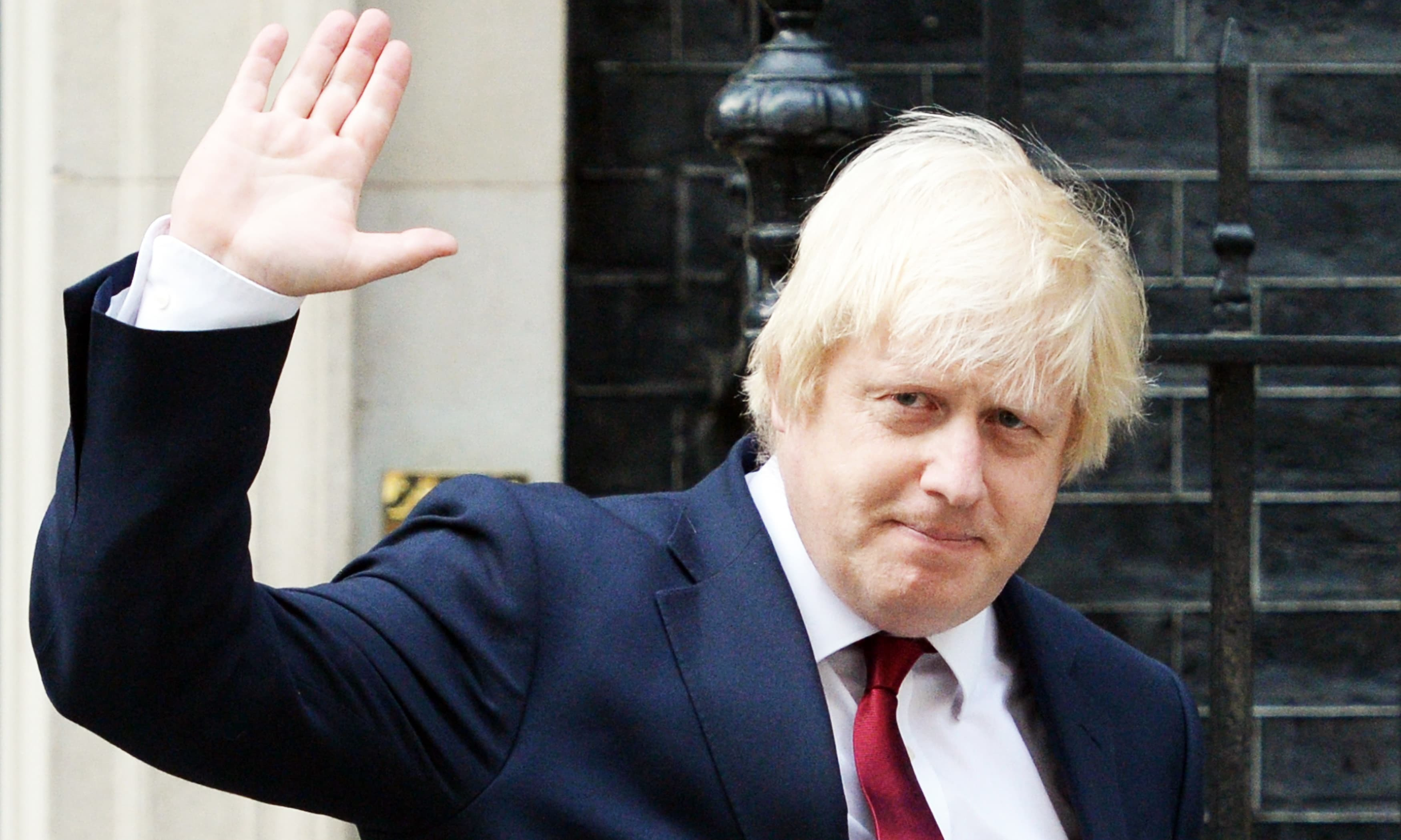 (FILES) In this file photo taken on July 13, 2016 Newly appointed Foreign Secretary Boris Johnson waves as he leaves 10 Downing Street in central Londonafter new British Prime Minister Theresa May took office.  British Foreign Secretary Boris Johnson has resigned, Downing Street said in a statement on July 9, 2018, hours after Brexit minister David Davis stepped down. / AFP PHOTO / OLI SCARFF — AFP or licensors