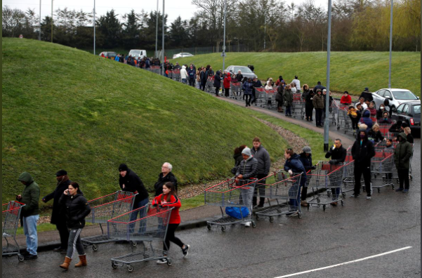 People queue outside of a Costco store in Watford, Britain, amid the spread of Covid-19 as UK considered a strategy of herd immunity, March 19. — Reuters